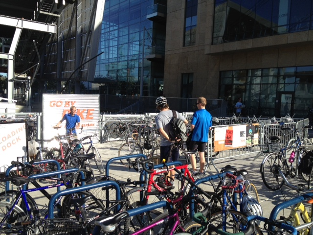 Kiel Johnson helps commuters at the Go By Bike valet service in Portland's South Waterfront