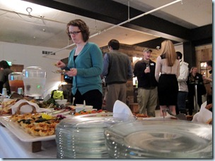 a Portlander scopes out the appetizer table at a MetroMile event Wednesday